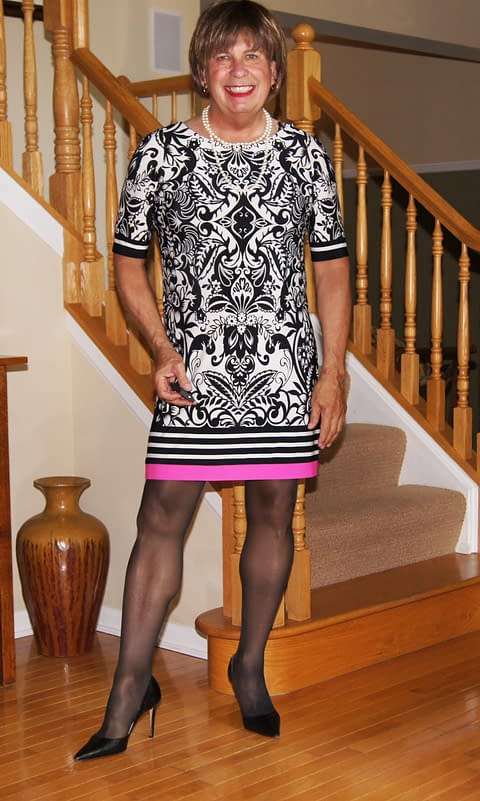 Another Spring Style Dress. I love the Pink stripe at the bottom