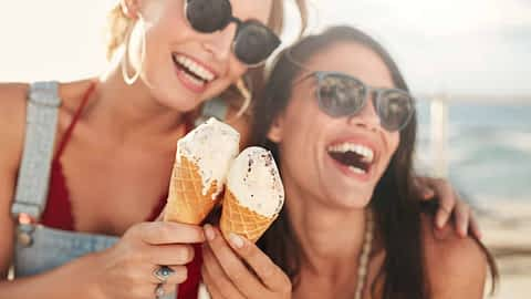 Girlfriends eating ice cream