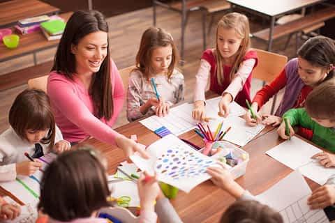 Men dressed as woman teaching kids