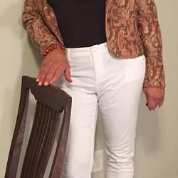 Skinny jeans and brocade jacket