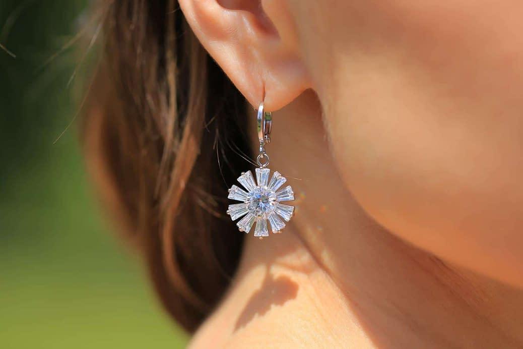 Crossdressing with silver earrings