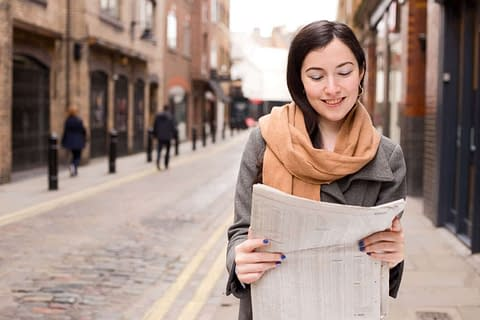 Crossdressing to pick up newspaper